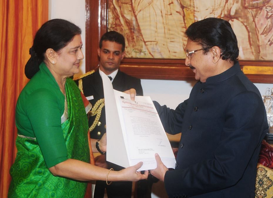 """Sasikala presents the letter to Governor Vidyasagar Rao. (Photo Courtesy: Twitter/<a href=""""https://twitter.com/AIADMKOfficial/status/829720452159328256"""">AIADMK</a>)"""