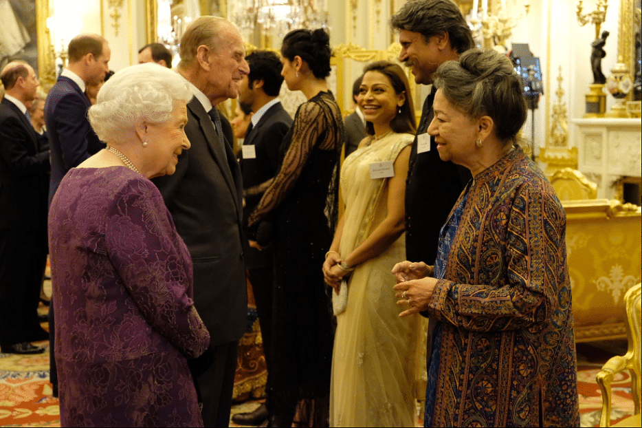 """Queen Elizabeth II and Prince Philip greet Aloka Mitra, founder of Women's Interlink Foundation. (Photo/Twitter<a href=""""https://twitter.com/RoyalFamily"""">@RoyalFamily</a>)"""