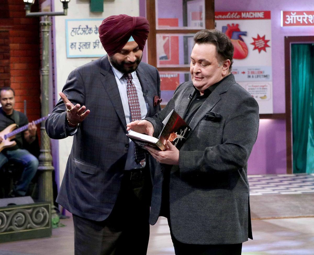 Rishi with Sidhu talking about his book, <i>Khullam Khulla</i>. (Photo: Yogen Shah)