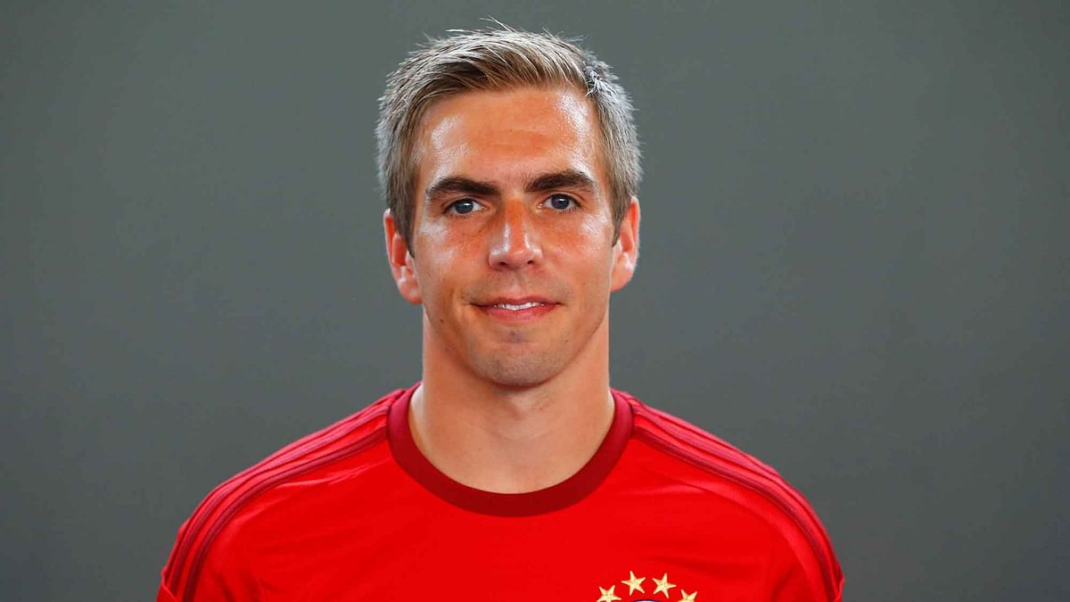 Bayern's Philipp Lahm poses during an official photo shooting for the upcoming German first division Bundesliga soccer season in Munich, Germany. (Photo: AP)