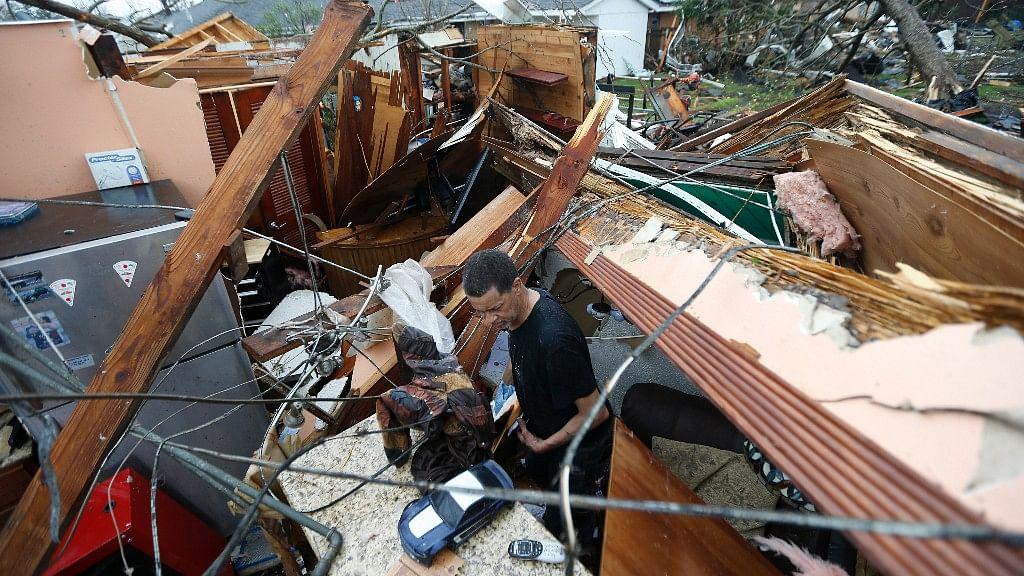 A man looks through the debris at his home after a tornado hit New Orleans, Louisinia. (Photo: AP)