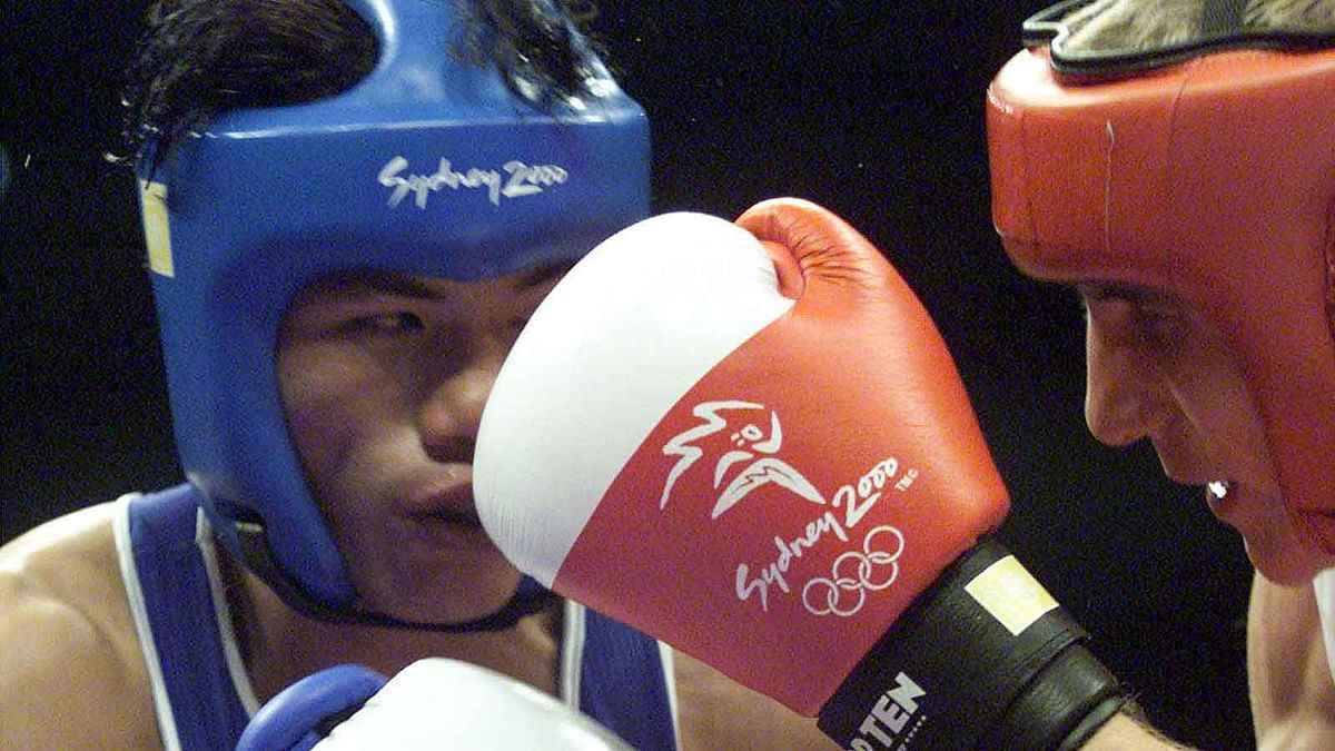 Dingko Ngangom Singh (L) in action during the Sydney Olympic Games, September 21, 2000. The former boxer has now been tested positive for coronavirus.