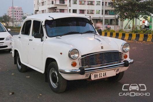 "The iconic Ambassador served well as a government car. (Photo Courtesy: <a href=""https://images2.cardekho.com/images/usedcarimages/large/2-2017/1611212/AmbyFront.jpg"">CarDekho</a>)"