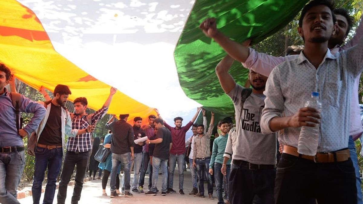 ABVP students hold a Tiranga march in DU's North Campus on Monday. (Photo: IANS)