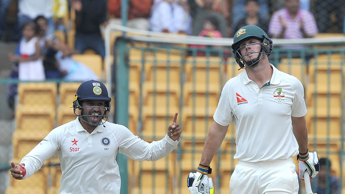 Karun Nair of India celebrate fall of Mitchell Marsh's wicket during the fourth day of the second test match between India and Australia at M. Chinnaswamy Stadium in Bengaluru. (Photo: BCCI)