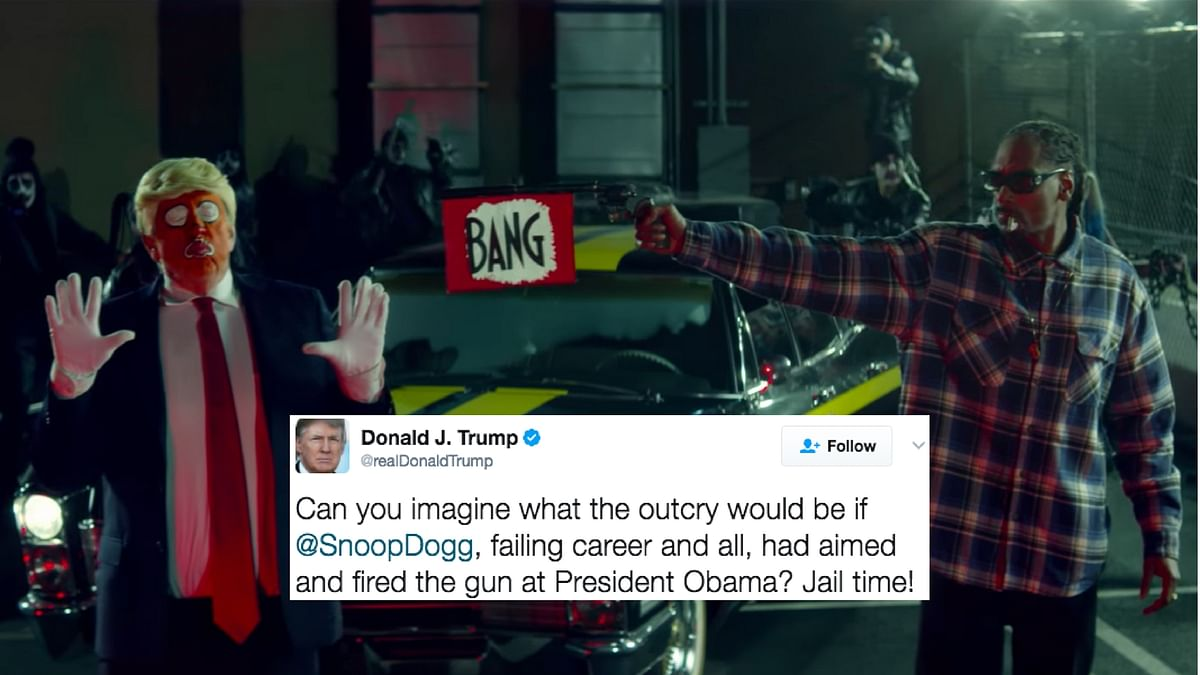 """The video shows the Rapper pointing a gun at a clown dressed as Donald Trump (Photo Courtesy: <a href=""""https://www.youtube.com/watch?v=E4i3bAtEuJE"""">YouTube</a>/<b>Altered by The Quint</b>)"""