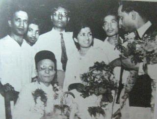 "VD Savarkar (seated) with Lata Mangeshkar. (Photo Courtesy: <a href=""http://www.savarkar.org/en/gallery"">Savarkar.org</a>)"
