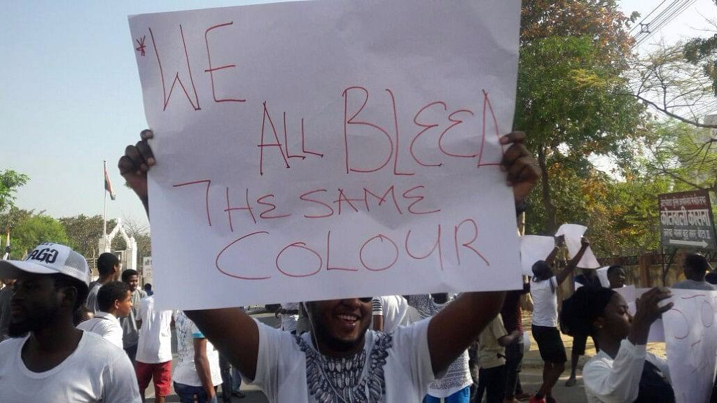 """Nigerian students held a protest against the arrest and cannibalism charges on Sunday. (Photo Courtesy: Facebook/ <a href=""""https://www.facebook.com/AssociationOfAfricanStudentsInIndia/"""">Association of African Students in India</a>)"""
