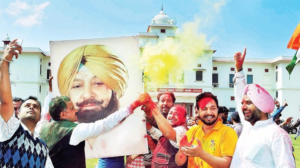 People celebrate Captain Amarinder Singh's victory. (Photo: PTI)