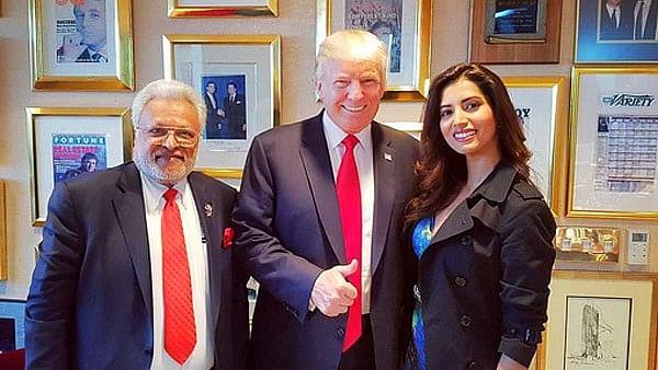 "US President Donald Trump flanked by Shalabh Kumar of Republican Hindi Coalition and his god-daughter Manasvi Mamgai. (Image courtesy: twitter.com/<a href=""https://twitter.com/imanasvi"">@imanasvi</a>)"