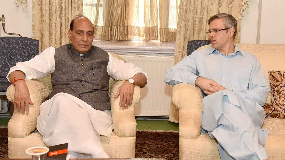 File picture of former Jammu and Kashmir chief minister Omar Abdullah with Union Home Minister Rajnath Singh in Srinagar. (Photo: IANS)