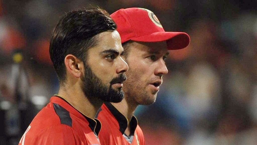 RCB's Virat Kohli and AB de Villiers may not be seen in the initial few weeks of the IPL. (Photo: IANS)