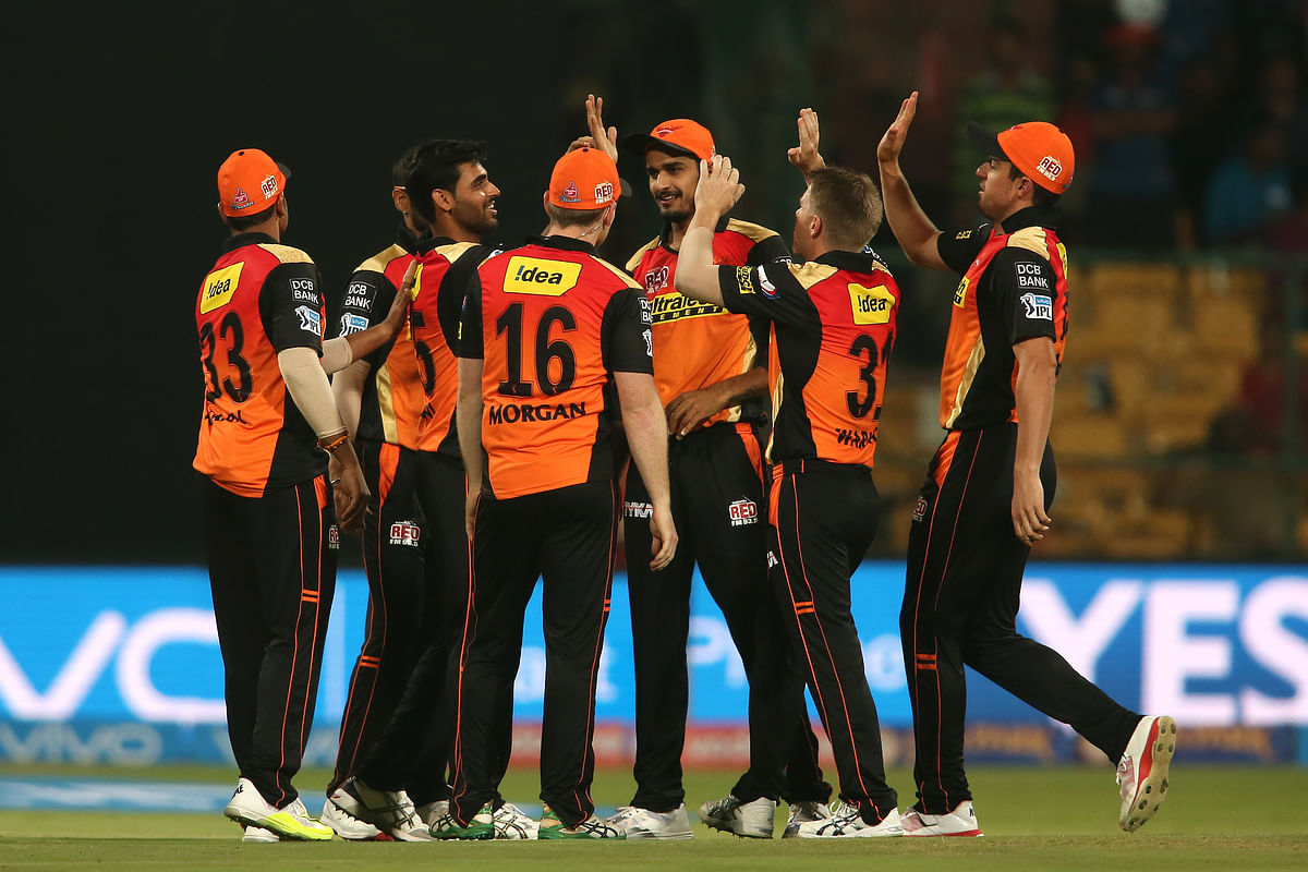 Bhuvneshwar Kumar celebrates with his teammates after picking up a wicket. (Photo: BCCI)