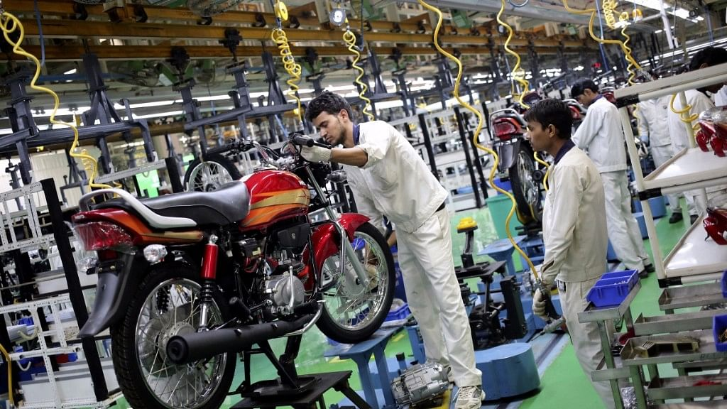 Employees work on an assembly line of Hero Motocorp during a media tour to the newly opened plant in Neemrana. (Photo: Reuters)