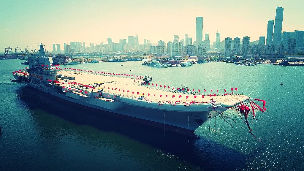 In this photo released by China's Xinhua News Agency, a newly-built aircraft carrier is transferred from dry dock into the water at a launch ceremony at a shipyard in Dalian in northeastern China's Liaoning Province, Wednesday, 26 April 2017. (Photo: AP)