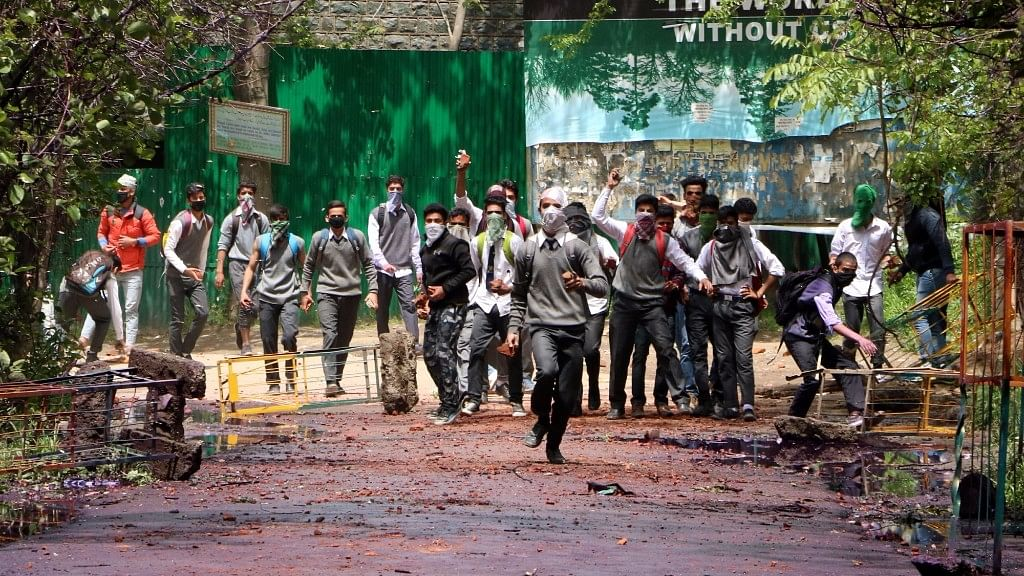 Students pelt stones at security personnel in Srinagar on 24 April 2017. (Photo: IANS)