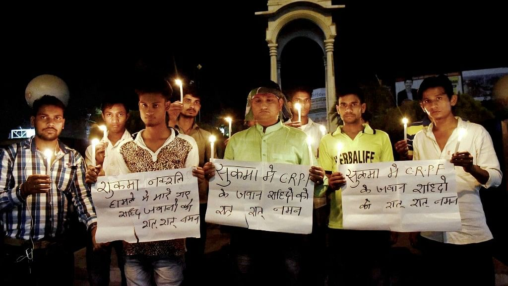 LJP activists take part in a candlelight vigil to pray for CRPF jawans lost their lives in a Naxal attack in Chhattisgarh's Sukma district, in Patna on Monday. (Photo: PTI)