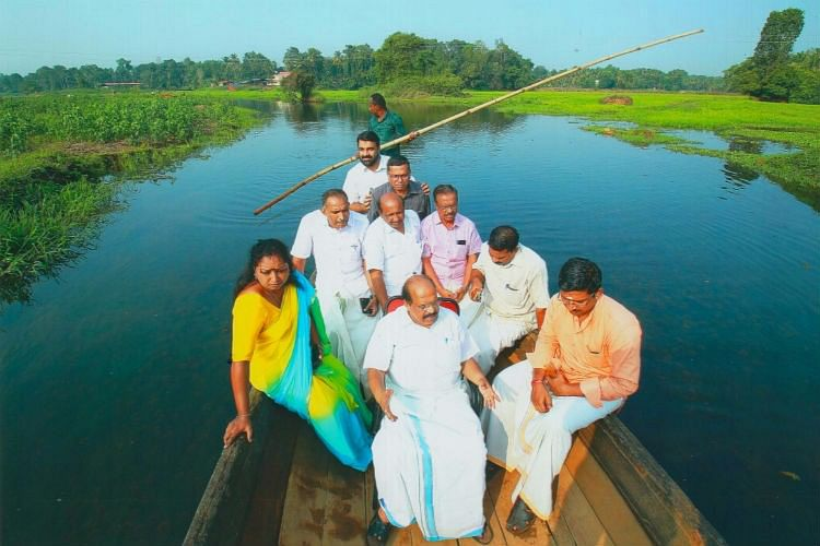 Minister G Sudhakaran taking a tour of the river on a boat, after its revival. (Photo: The News Minute)