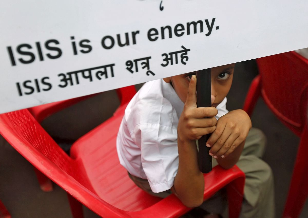 A Muslim boy looks on as he holds a placard at a rally organised by a Muslim charitable trust in Mumbai, India, November 26, 2015. (Photo: Reuters)