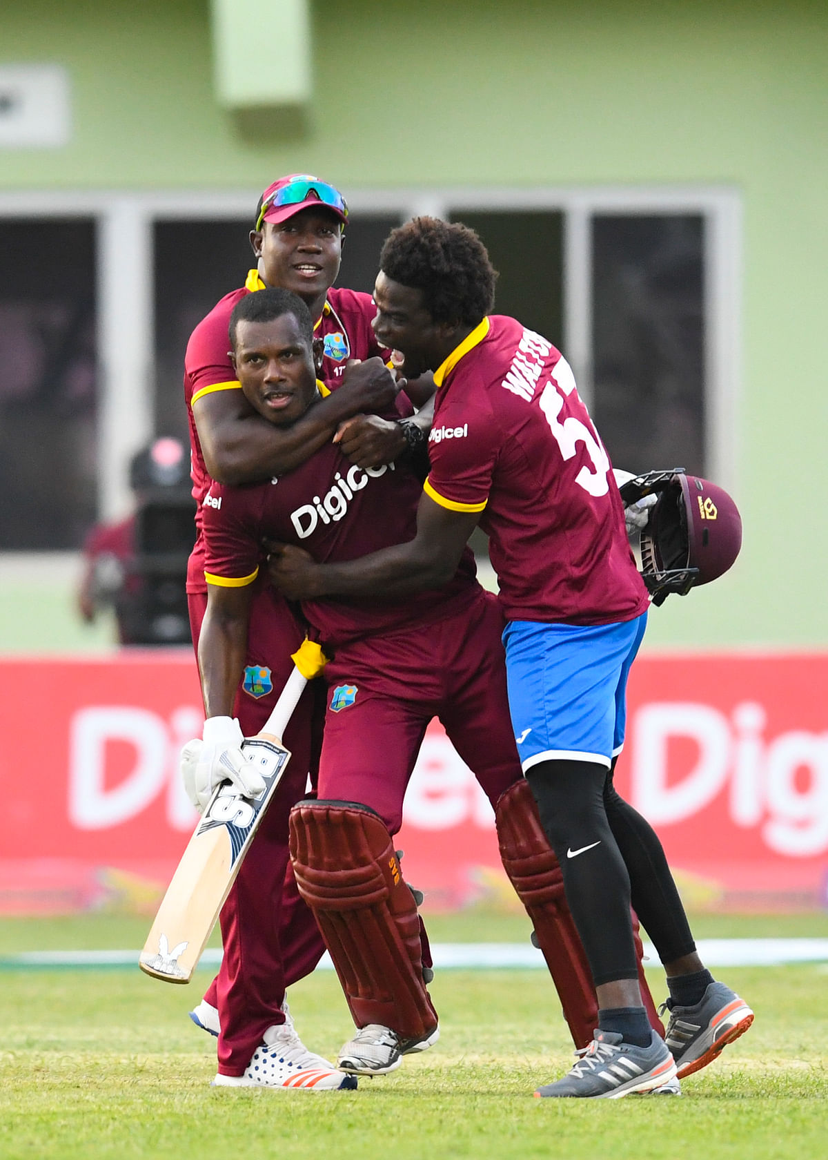 Teammates hug Mohammed after he gets them past the finish line. (Photo: WICB)