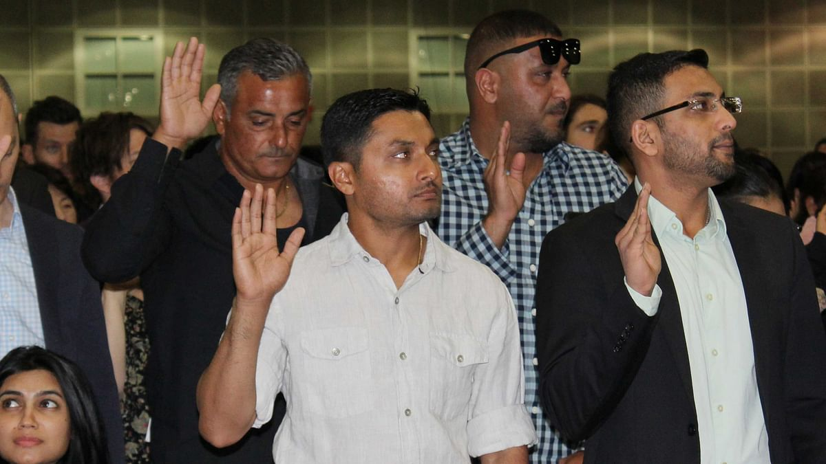 Indian-born U.S. national cricket team player Timil Kaushik Patel, second from left, takes an oath as a naturalized U.S. citizen at a ceremony in Los Angeles, Tuesday, April 18, 2017. (Photo: AP)