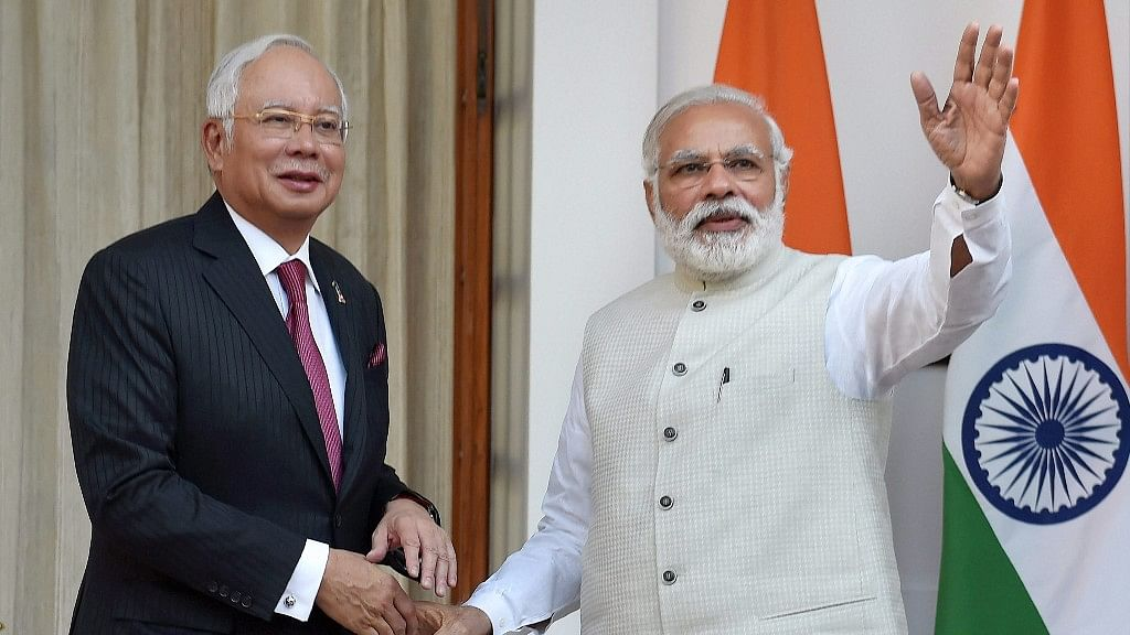 Prime Minister Narendra Modi greets his Malaysian counterpart Najib Razak in New Delhi on Saturday. (Photo: PTI)