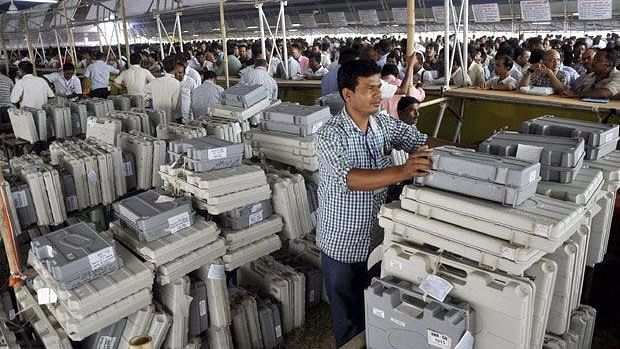 Polling officials collecting Electronic Voting Machines. (Photo: PTI)