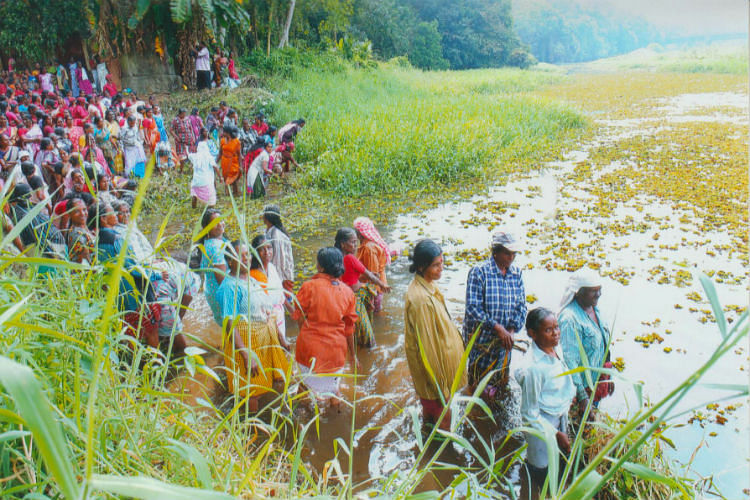 Labourers cleaning the river. (Photo Courtesy: The News Minute)