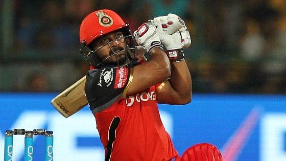 RCB's Kedar Jadhav hits a shot during the IPL match against Delhi Daredevils. (Photo: BCCI)