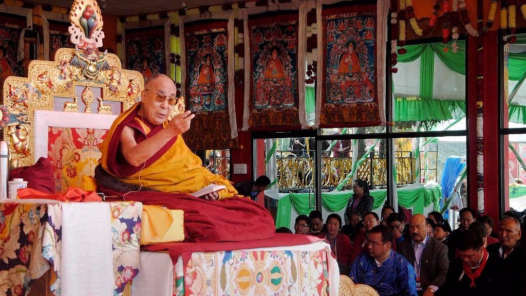 Tibetan spiritual leader Dalai Lama addressing devotees during a spiritual discourse at Yid-Ga-Choezin, in Tawang district of Arunachal Pradesh on Saturday. (Photo: PTI)