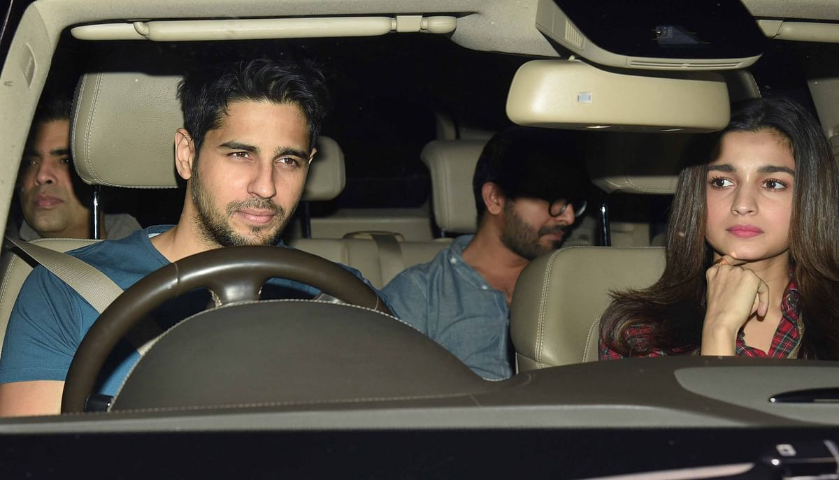 Sidharth, Alia and Karan arrive together. (Photo: Yogen Shah)