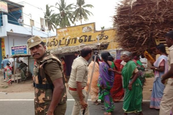 The incident happened as women were marching on the road in Samalapuram against a liquor shop being relocated to the area. (Photo Courtesy: The News Minute)