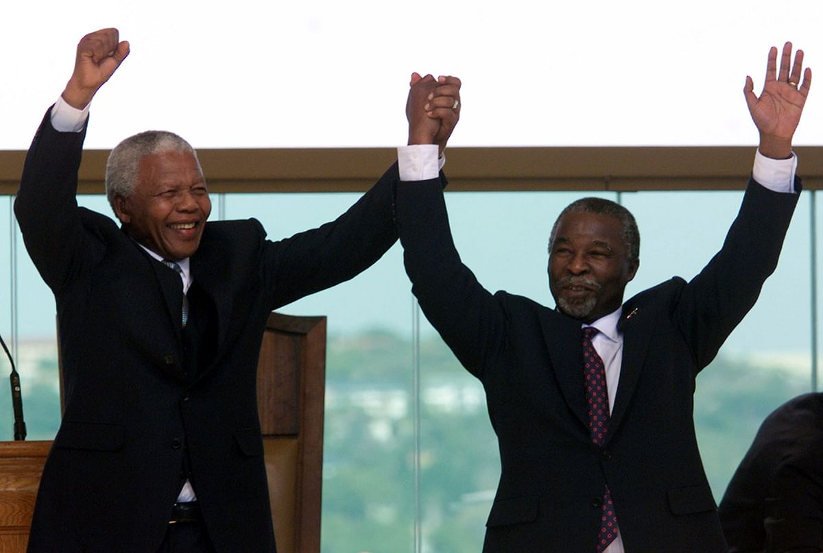 Mandela confided in the author all the details in his Johannesburg bungalow after he had handed over the Presidency to his successor, Thabo Mbeki (right). (Photo: Reuters)