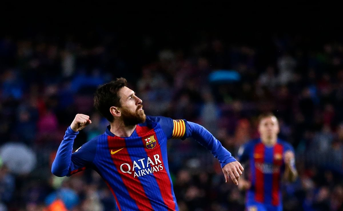 FC Barcelona's Lionel Messi, left, celebrates after scoring during the Spanish La Liga match between FC Barcelona and Osasuna. (Photo: AP)