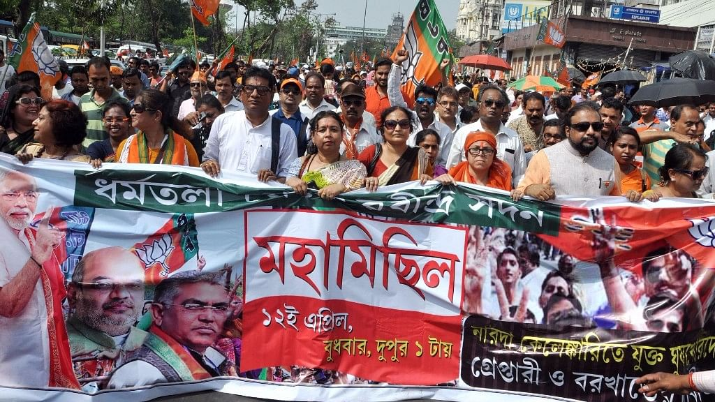 BJP workers stage a demonstration during a protest against West Bengal government in Kolkata, on April 12, 2017. (Photo: IANS)