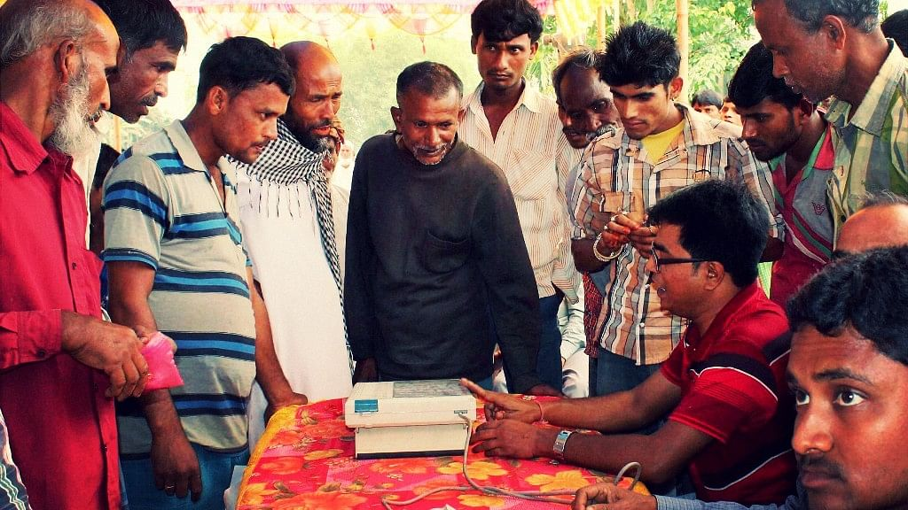 Election Commission officials demonstrating the handling of EVM. Image used for representational purposes. (Photo: PTI)