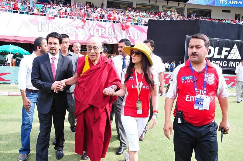 The Dalai Lama with Anurag Thakur and Preity Zinta during an IPL game. (Photo Courtesy: HPCA)