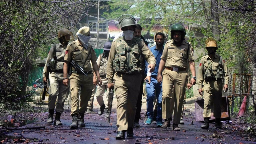 Police forces walking past stones pelted by students in J&K. Representative image.