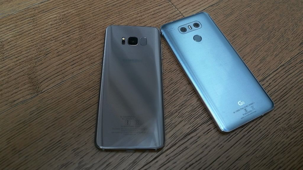 Both the phones have a glass-back body. (Photo: <b>The Quint)</b>
