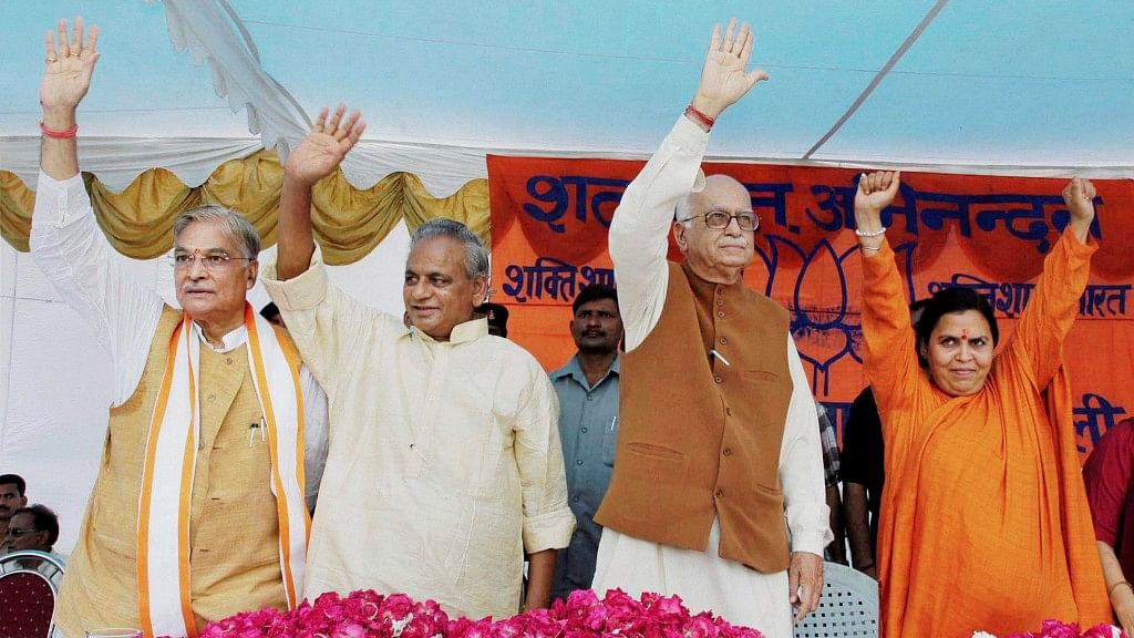 <i>(From left)</i> Murli Manohar Joshi, Kalyan Singh, LK Advani and Uma Bharti wave at the crowd at a public meeting after appearing in a special court in connection with the demolition of Ayodhya's Babri Masjid, in Rae Bareilly, on 28 July, 2005.&nbsp;