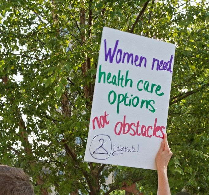 A protest demanding safe and basic healthcare for women during a march in the US. (Photo: iStock)