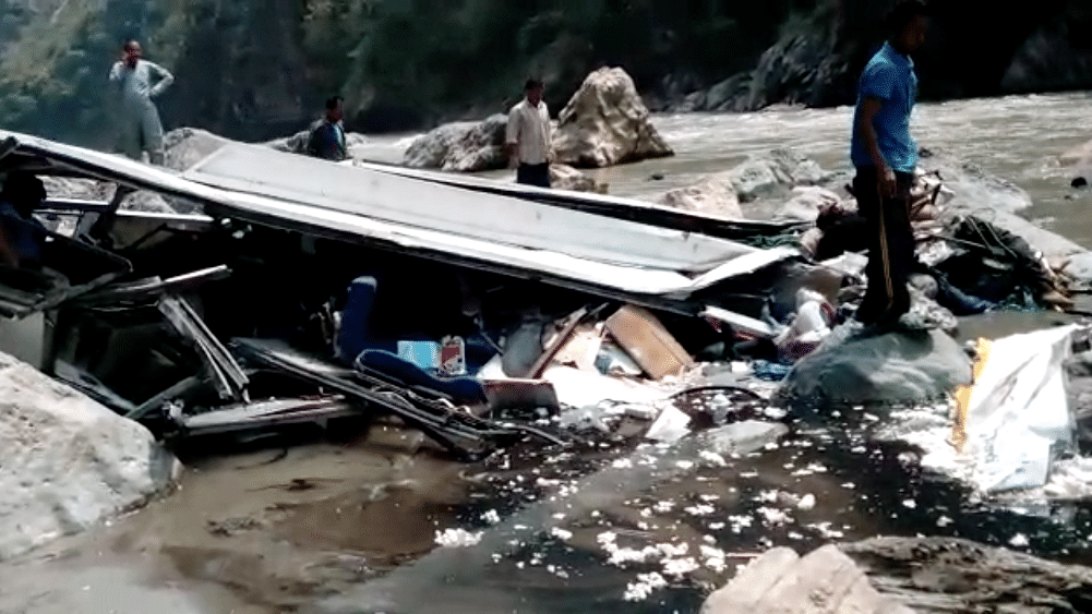 A view of the private bus that crashed into the Tons River in Shimla, killing at least 43 people. (Photo Courtesy: Video screengrab)