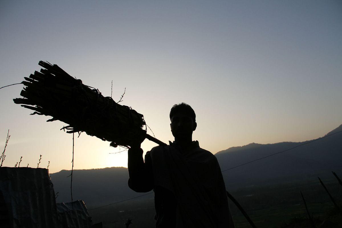 Kashmiri Muslim villagers carrying torches walk on a mountain trail to reach the cave shrine of Sakhi Zain-ud-din Wali. (Photo: Muneeb ul Islam)
