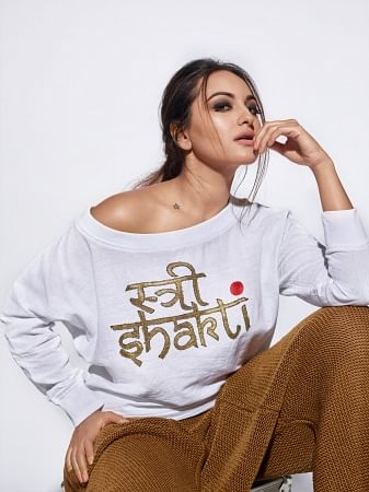 Sonakshi SInha posing in a custom designed Abraham and Thakore tee for an Elle issue. (Photo Courtesy: Abraham and Thakore)