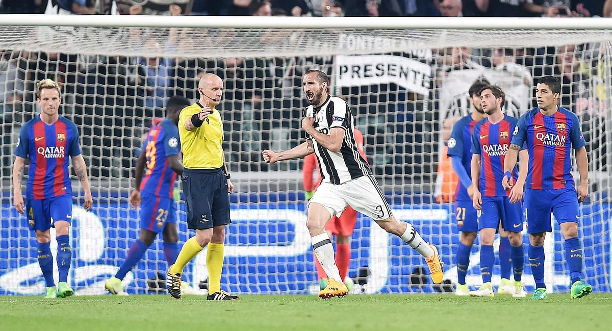 Juventus' Giorgio Chiellini celebrates after scoring his side's third goal. (Photo: AP)