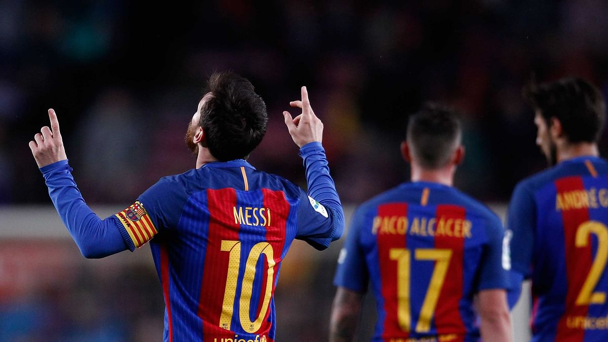 FC Barcelona's Lionel Messi, left, celebrates after scoring during the Spanish La Liga soccer match between FC Barcelona and Osasuna at the Camp Nou. (Photo: AP)