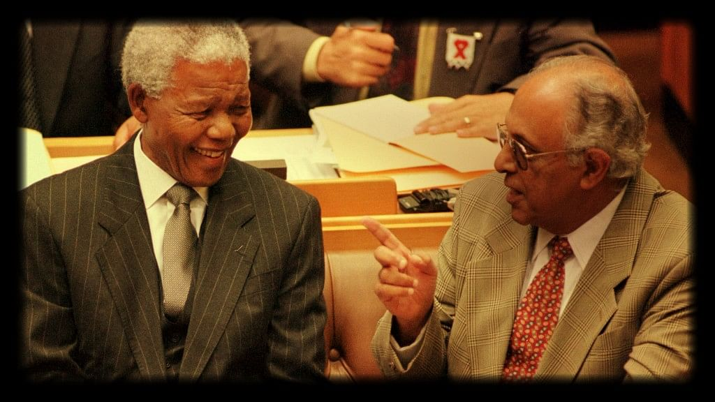 President Nelson Mandela talks to Indian-origin veteran politician Ahmed Kathrada before Mandela's address to Parliament in Cape Town on 2 March 1999. (Photo: Reuters)