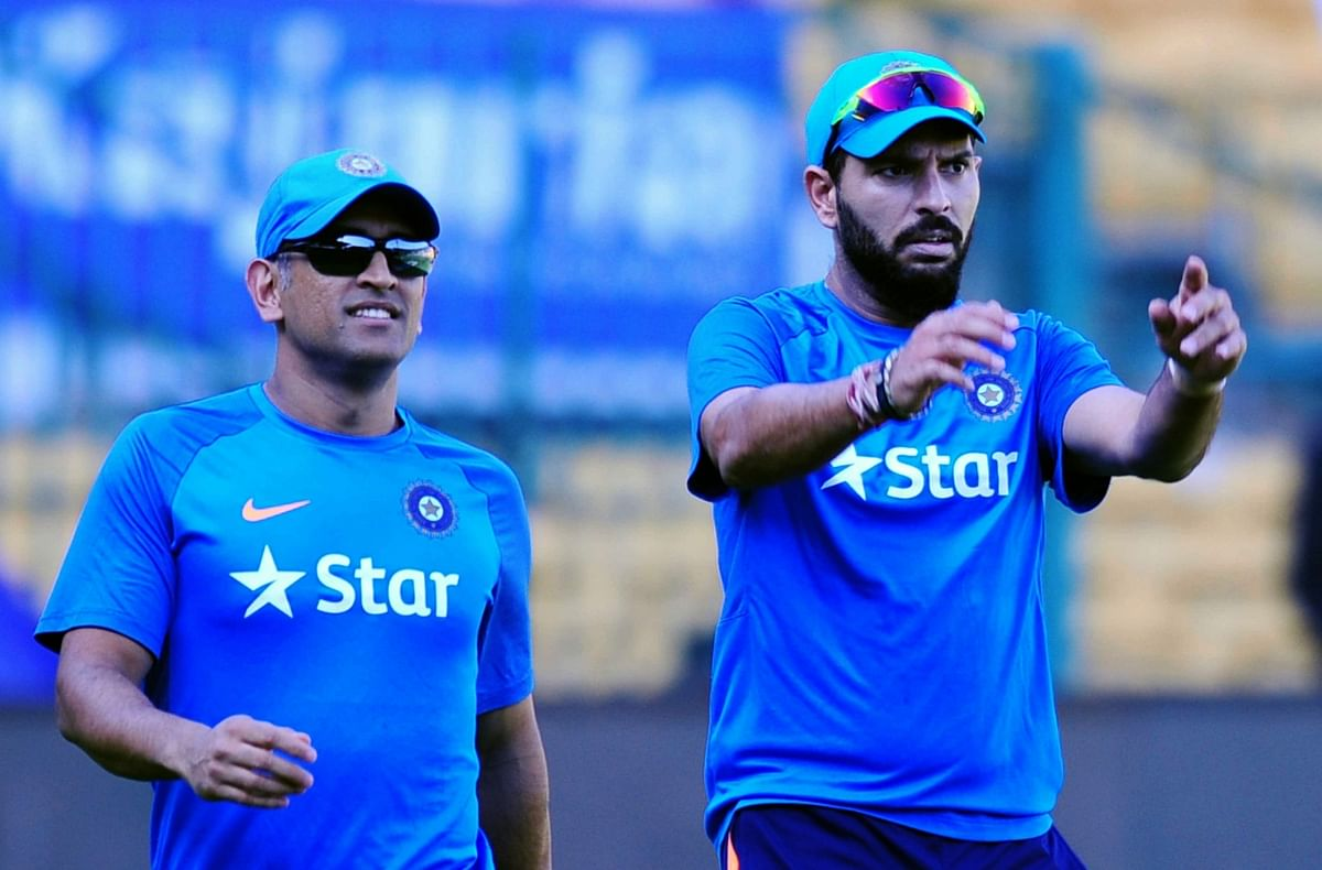 Yuvraj at a training session with MS Dhoni before the England series. (Photo: IANS)