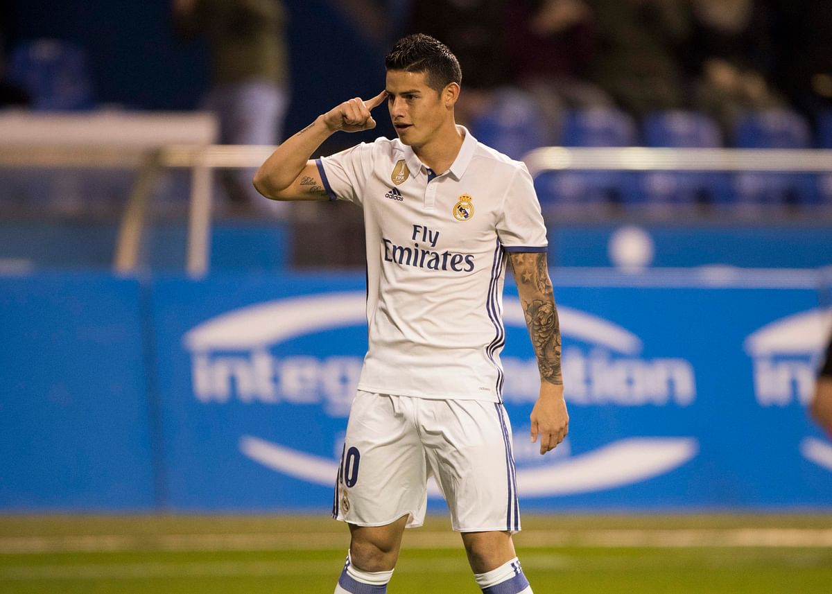 Real Madrid's James Rodriguez gestures after scoring a goal during a La Liga match between Deportivo La Coruna and Real Madrid. (Photo: AP)