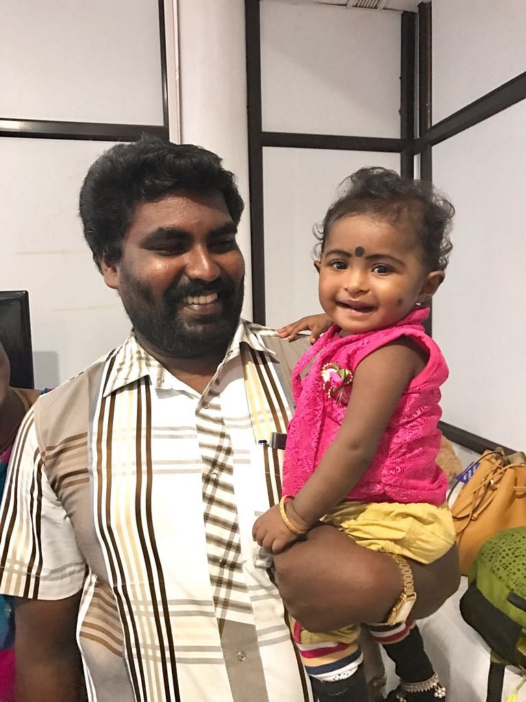 Darshini, the mischievous little girl pictured above, is a year old. She was operated for VSD at 11 months. Her father is a clerk in a school, in Madhurai. (Photo: <b>The Quint</b>)